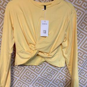NWT. Yellow long sleeve crop top. XL